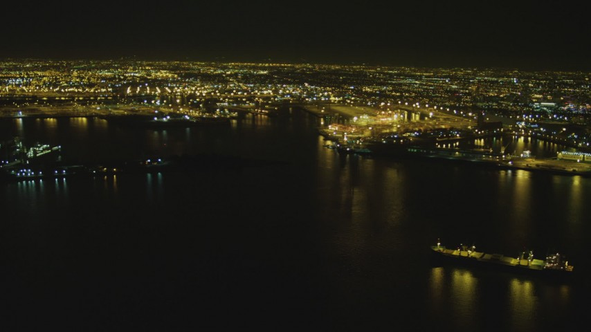 4K stock footage aerial video of flying by the Port of Long Beach, Long Beach, California, night Aerial Stock Footage | DCA07_150