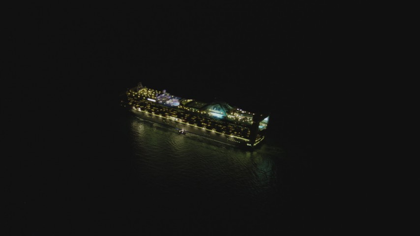 4K stock footage aerial video of orbiting a cruise ship sailing near Port of Los Angeles, San Pedro, California, night Aerial Stock Footage | DCA07_153