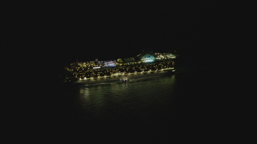 4K stock footage aerial video of orbiting a cruise ship sailing near the Port of Los Angeles, San Pedro, California, night Aerial Stock Footage | DCA07_154