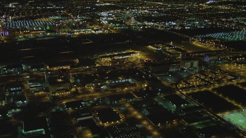 4K stock footage aerial video of tracking passenger jet landing, LAX (Los Angeles International Airport), Los Angeles, California, night Aerial Stock Footage   DCA07_164