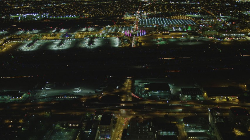 4K stock footage aerial video of tracking passenger jet taxiing, LAX (Los Angeles International Airport), Los Angeles, California, night Aerial Stock Footage | DCA07_165