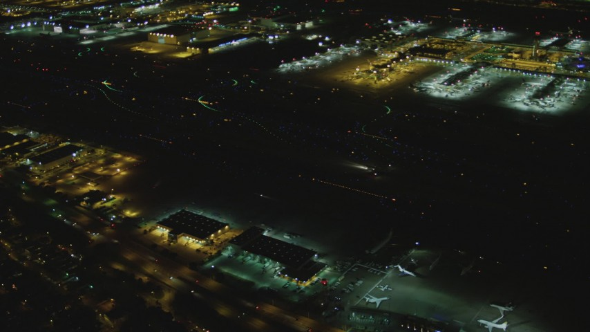4K stock footage aerial video of a passenger jet taxiing, LAX (Los Angeles International Airport), Los Angeles, California, night Aerial Stock Footage | DCA07_166
