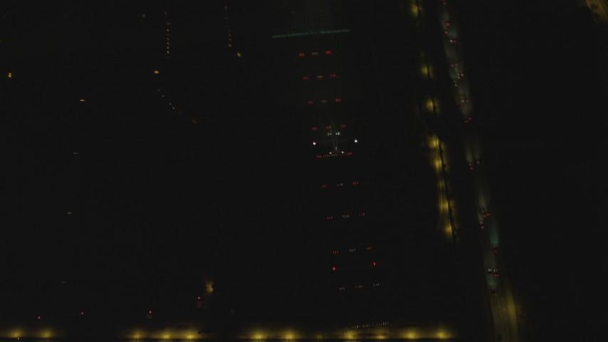 4K stock footage aerial video of a passenger jet landing, LAX (Los Angeles International Airport), Los Angeles, California, night Aerial Stock Footage   DCA07_168