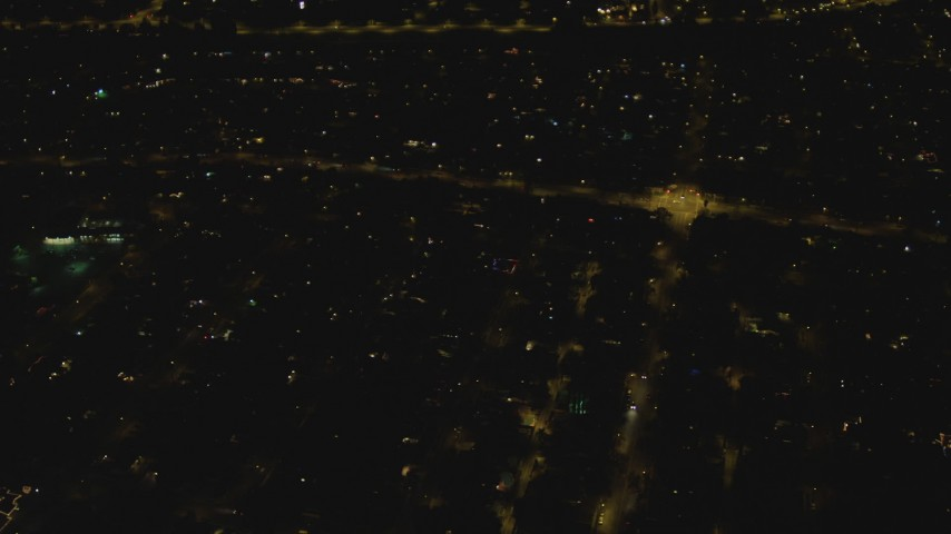 4K stock footage aerial video of approaching an intersection, residential neighborhood, Woodland Hills, California, night Aerial Stock Footage | DCA07_180