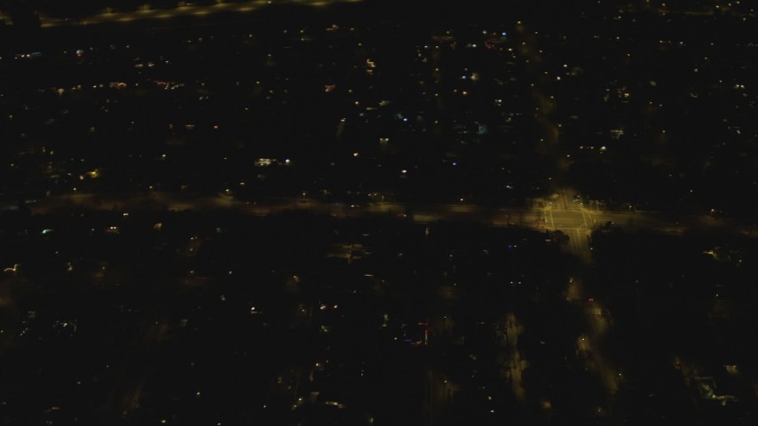 4K stock footage aerial video of panning across residential neighborhood, Woodland Hills, California, night Aerial Stock Footage   DCA07_181