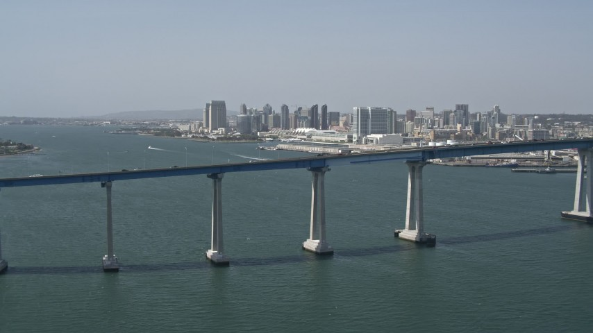 4K stock footage aerial video of the Coronado Bridge, and Downtown San Diego in the background, California Aerial Stock Footage | DCA08_017