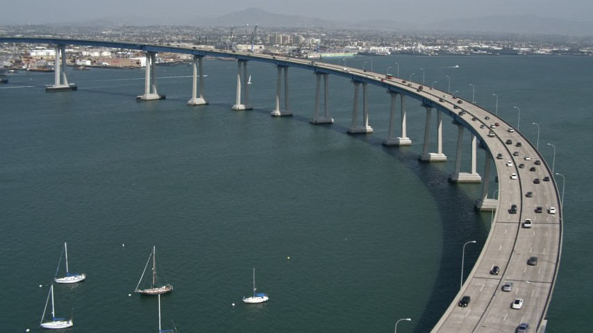 4K stock footage aerial video of tracking light traffic on the Coronado Bridge, San Diego, California Aerial Stock Footage | DCA08_020