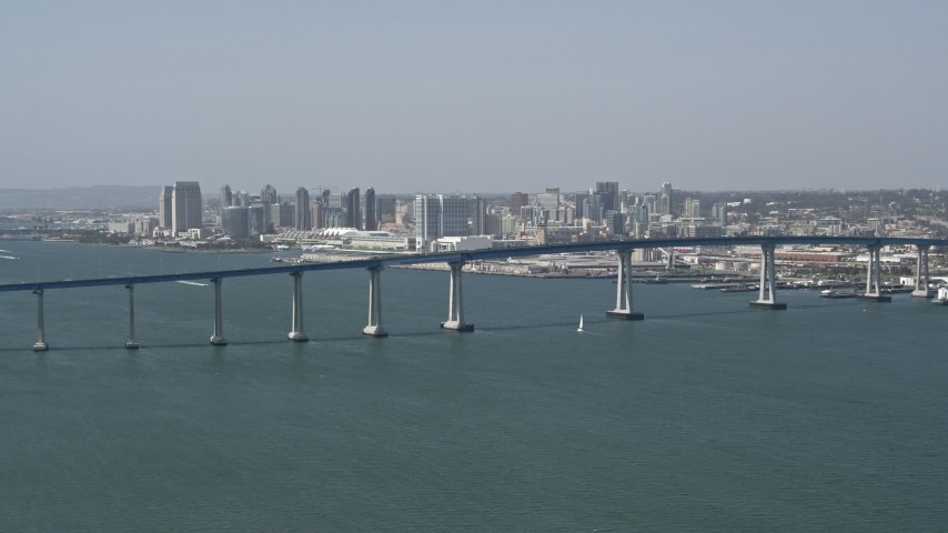 4K aerial video of a reverse view of the Coronado Bridge and city skyline of Downtown San Diego, California Aerial Stock Footage | DCA08_024