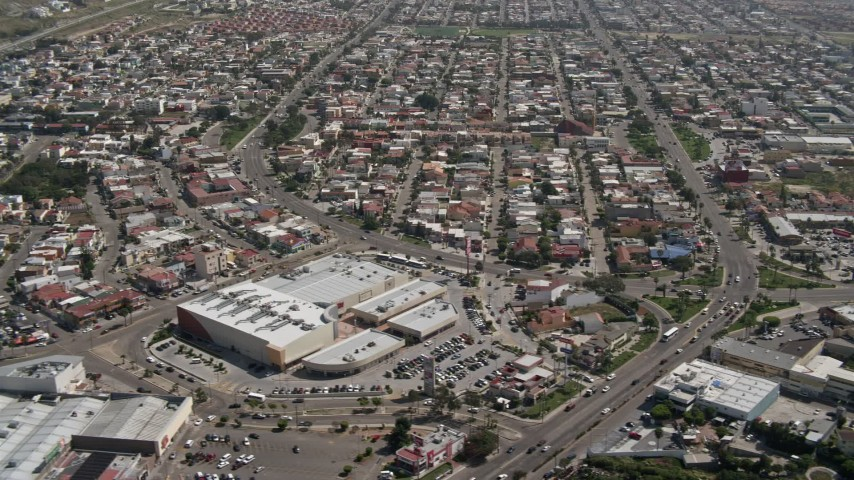 4K stock footage aerial video of a shopping center and urban neighborhood, Tijuana, Mexico Aerial Stock Footage | DCA08_042
