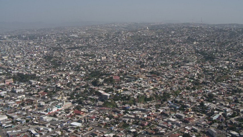 4K aerial video of a view of dense urban neighborhoods in Tijuana, Mexico Aerial Stock Footage | DCA08_047