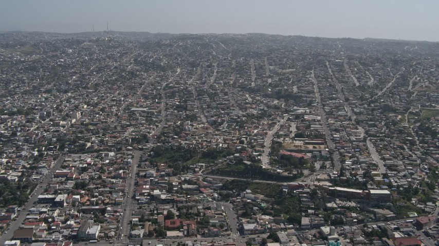 4K stock footage aerial video of a view of urban residential neighborhoods in Tijuana, Mexico Aerial Stock Footage DCA08_048
