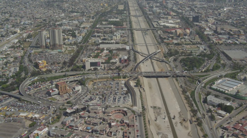 4K stock footage aerial video flyby urban neighborhoods to reveal traffic to the border, Tijuana, Mexico Aerial Stock Footage | DCA08_049