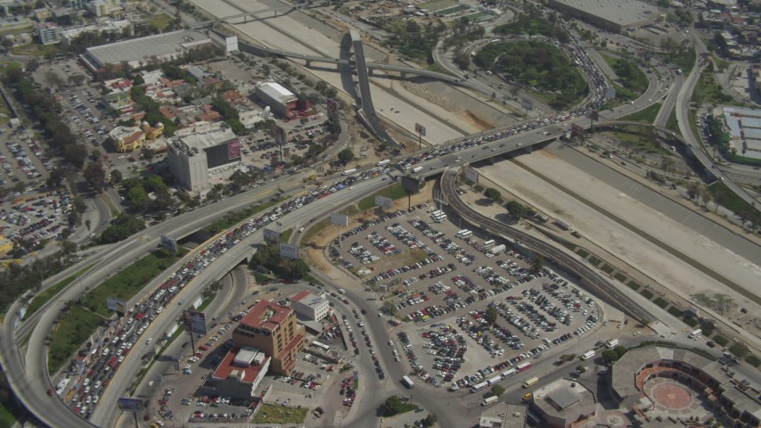 4K aerial video orbit heavy traffic on the US/Mexico Border, Tijuana Aerial Stock Footage | DCA08_050