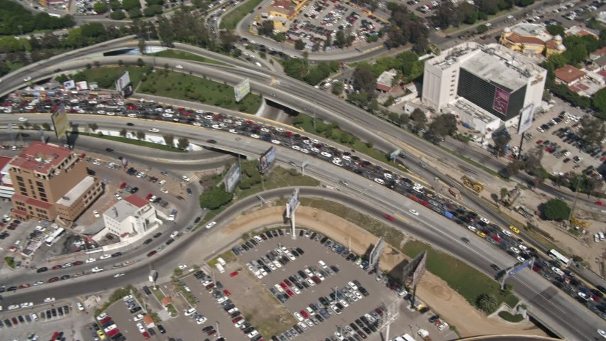 4K aerial video tilt to a bird's eye view of heavy traffic on the US/Mexico Border, Tijuana Aerial Stock Footage | DCA08_051