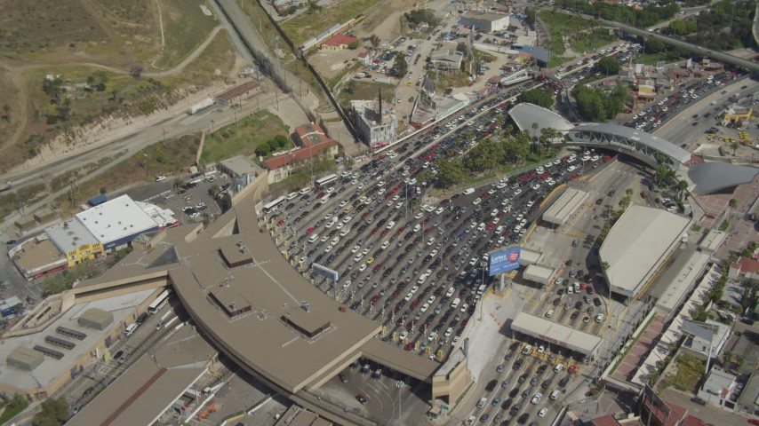 4K aerial video orbit heavy border checkpoint traffic, US/Mexico Border, Tijuana Aerial Stock Footage | DCA08_052