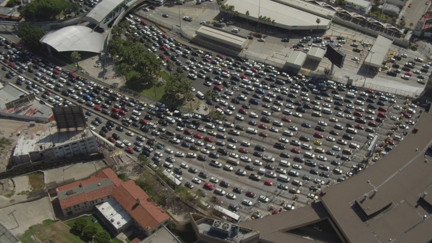 4K aerial video of orbiting heavy traffic at the checkpoint, US/Mexico Border, Tijuana Aerial Stock Footage | DCA08_053