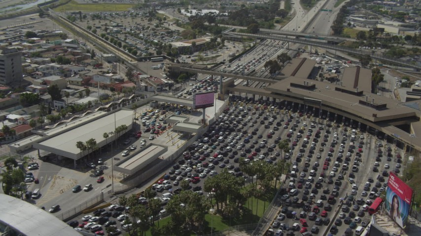 4K aerial video orbit heavy traffic waiting at the US/Mexico Border, Tijuana Aerial Stock Footage | DCA08_057