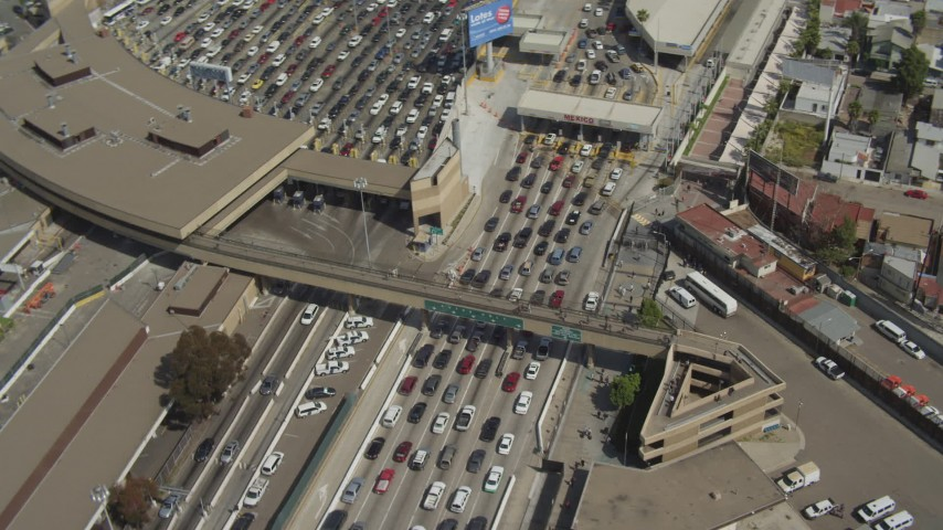 4K aerial video orbit rows of cars at the US/Mexico Border, Tijuana Aerial Stock Footage DCA08_058