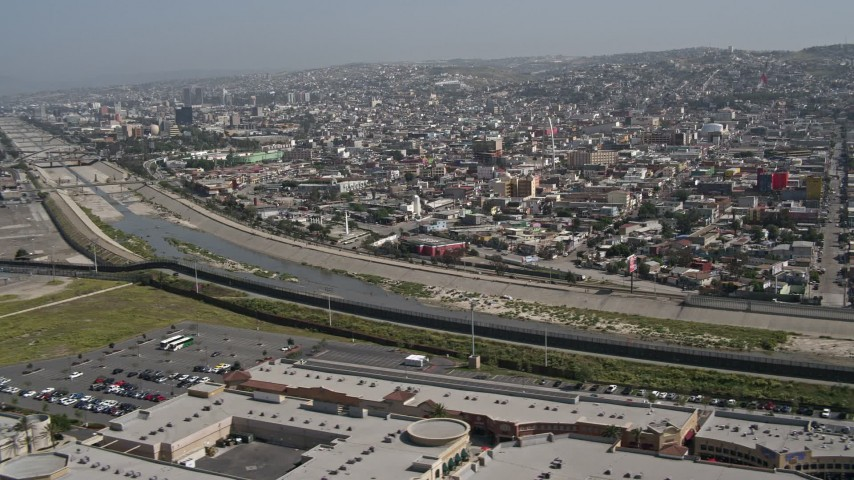 4K aerial video of the border fence and Rio Tijuana, US/Mexico Border, Tijuana Aerial Stock Footage | DCA08_059