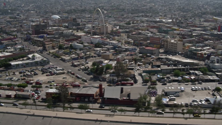 4K stock footage aerial video of a reverse view of urban homes, reveal Tijuana Arch, Tijuana, Mexico Aerial Stock Footage | DCA08_061