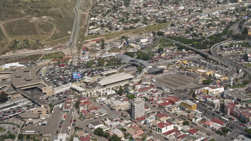4K stock footage aerial video approach and tilt to heavy border traffic on the US/Mexico Border, Tijuana Aerial Stock Footage | DCA08_063