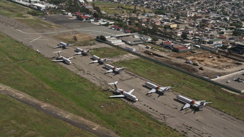 4K stock footage aerial video orbit commercial airplanes at Tijuana International Airport, Mexico Aerial Stock Footage | DCA08_067