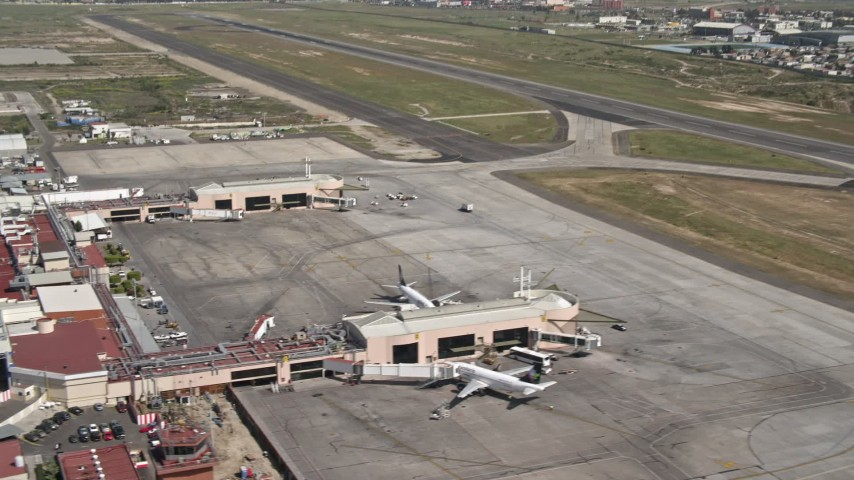 4K stock footage aerial video of terminals, passenger jets, and hangars at Tijuana International Airport, Mexico Aerial Stock Footage | DCA08_068