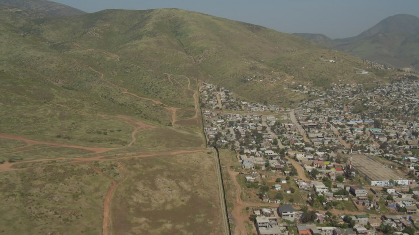4K aerial stock footage video of following the border fence to mountains, US/Mexico Border, Mexico Aerial Stock Footage DCA08_074