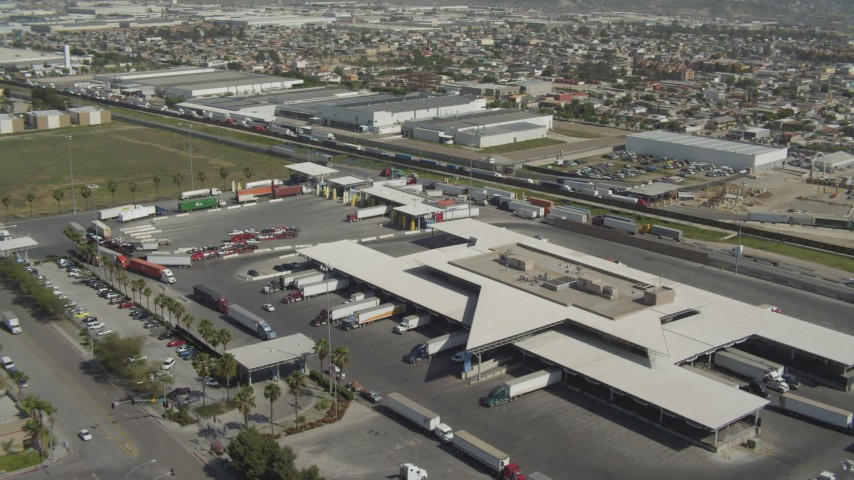 4K aerial video orbit Otay Mesa Port of Entry on the US/Mexico Border, Otay Mesa, California Aerial Stock Footage | DCA08_087