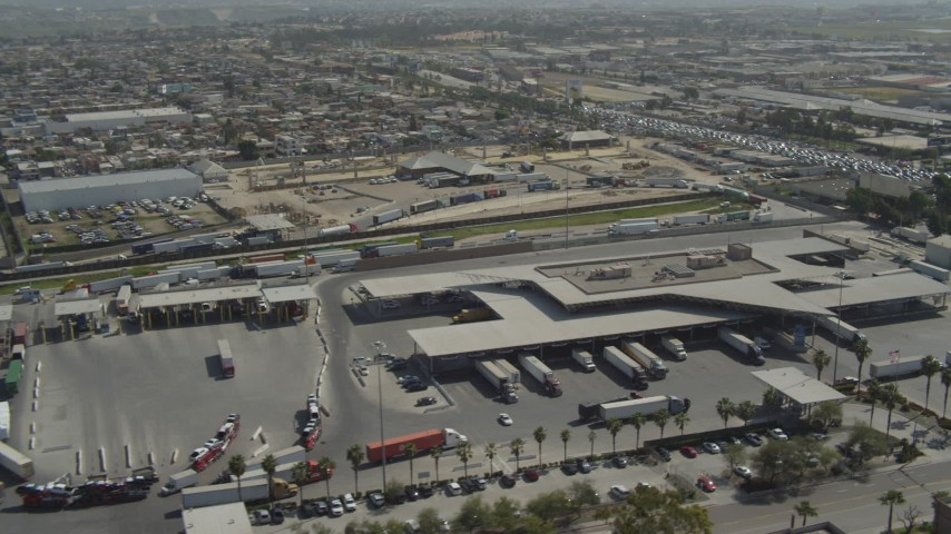 4K aerial video of orbiting the border crossing on the US/Mexico Border in Otay Mesa, California Aerial Stock Footage | DCA08_088