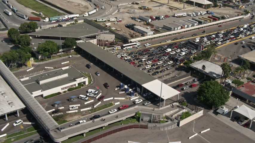 4K aerial video of a reverse view of the US/Mexico Border crossing in Otay Mesa, California Aerial Stock Footage | DCA08_091