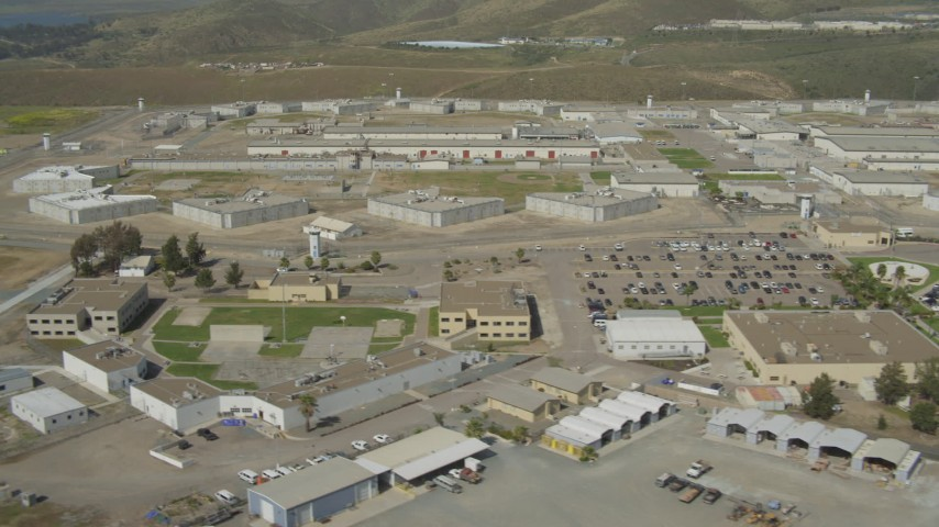 4K stock footage aerial video of flying by a large prison complex, Otay Mesa, California Aerial Stock Footage | DCA08_104