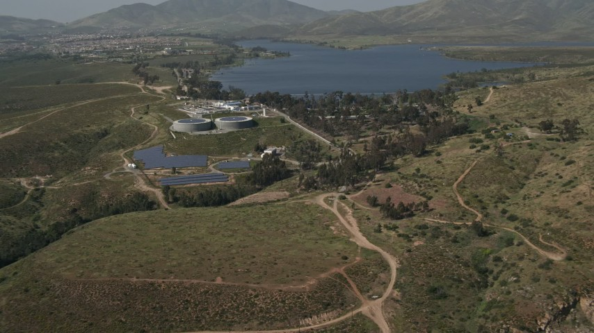4K stock footage aerial video of a lakeside water treatment plant, Lower Otay Lake, California Aerial Stock Footage | DCA08_107