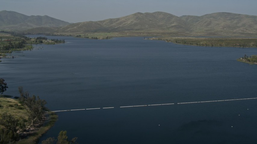 4K stock footage aerial video fly over a water treatment plant to reveal Lower Otay Lake, California Aerial Stock Footage | DCA08_108
