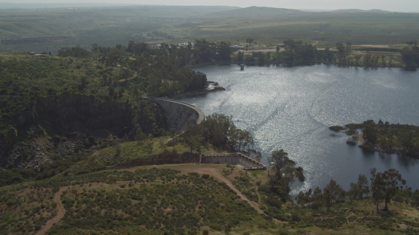 4K stock footage aerial video of orbiting a dam and Lower Otay Lake, California Aerial Stock Footage | DCA08_109