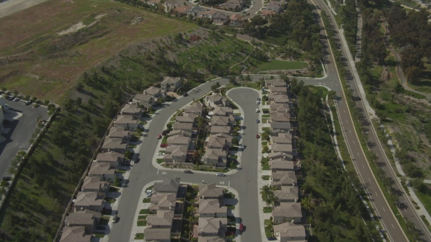 4K aerial video of flying over suburban tract homes, Chula Vista, California Aerial Stock Footage DCA08_117