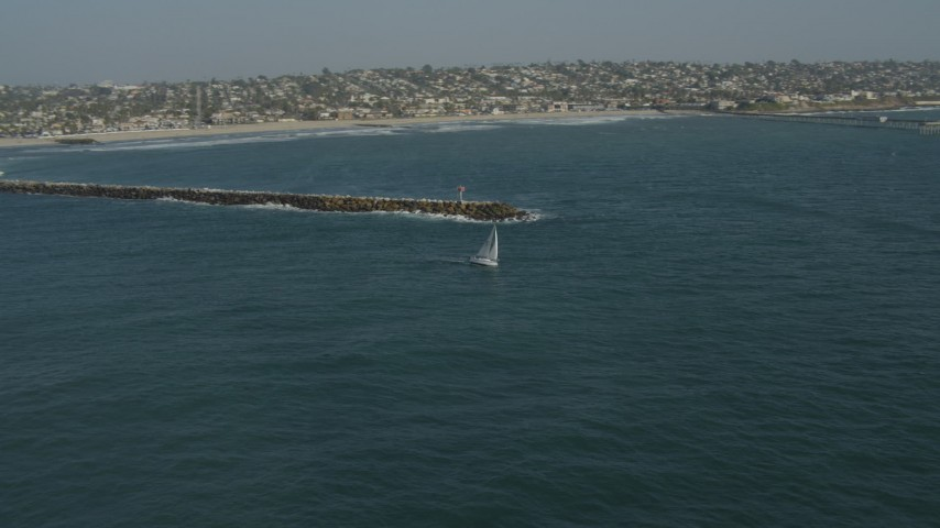 4K stock footage aerial video orbit a sailboat by a breakwater in Mission Beach, California Aerial Stock Footage | DCA08_156