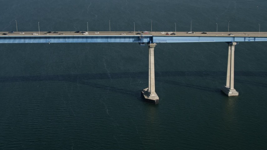 4K stock footage aerial video tilt from sailboat to reveal the Coronado Bridge, San Diego, California Aerial Stock Footage | DCA08_183