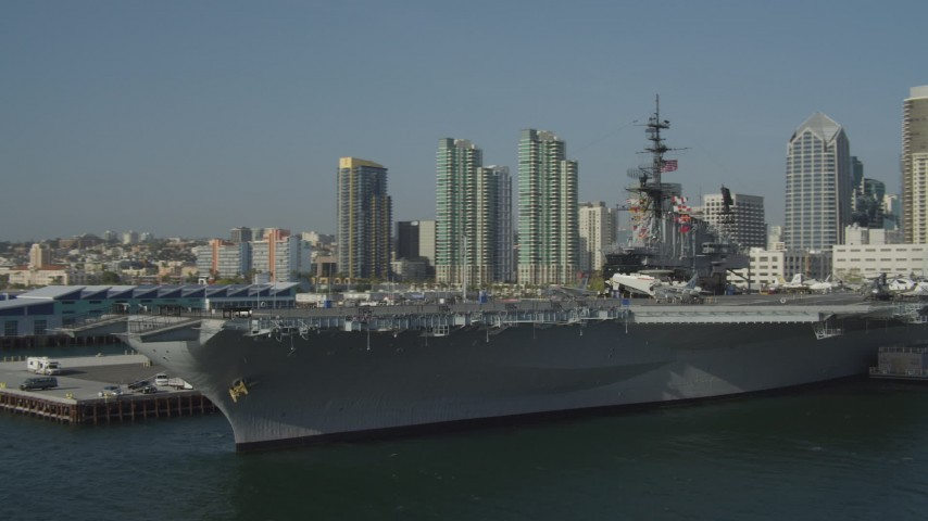 4K stock footage aerial video orbit the docked aircraft carrier, USS Midway, in Downtown San Diego, California Aerial Stock Footage DCA08_197