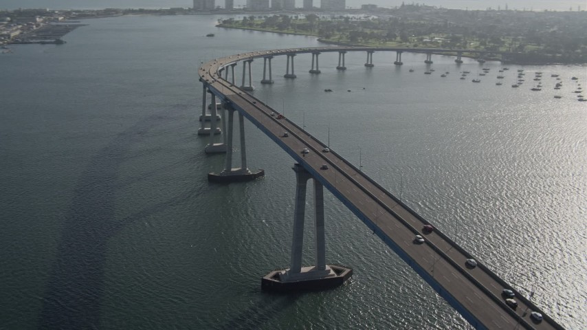 4K stock footage aerial video of tracking cars crossing the Coronado Bridge, San Diego, California Aerial Stock Footage | DCA08_203