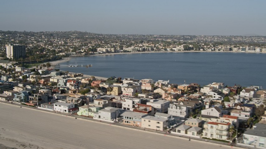 4K stock footage aerial video of passing by beachfront condos and a bay, Mission Beach, California Aerial Stock Footage | DCA08_234