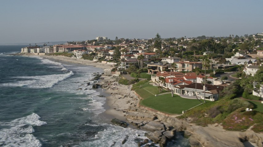 4K aerial video of flying by upscale homes in an oceanfront neighborhood, La Jolla, California Aerial Stock Footage | DCA08_243
