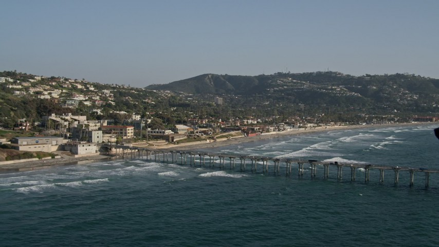 4K stock footage aerial video tilt from the ocean to reveal a pier in La Jolla, California Aerial Stock Footage | DCA08_249