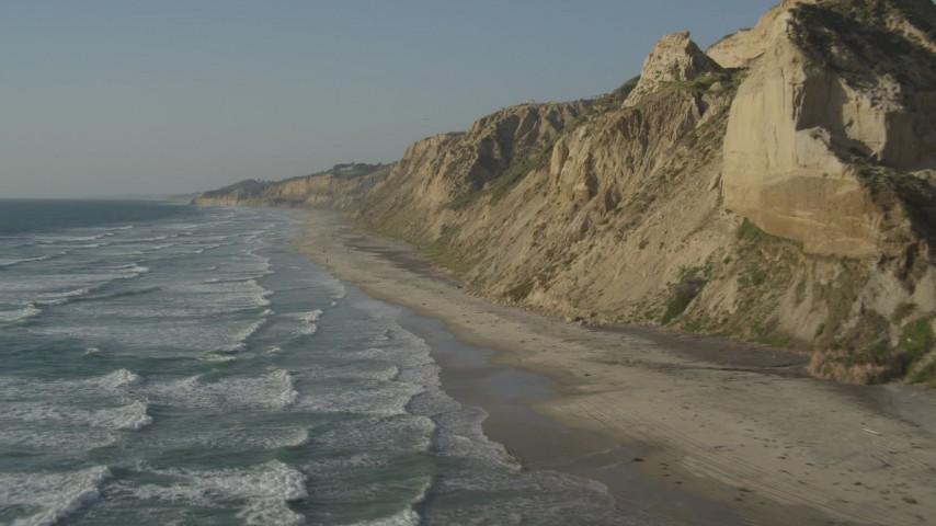 4K stock footage aerial video pan across coastal cliffs and beach, La Jolla, California Aerial Stock Footage | DCA08_251
