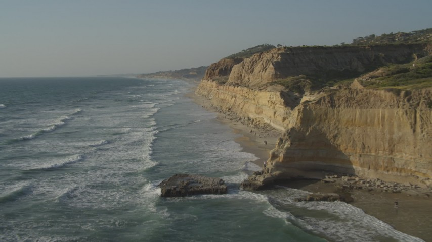 4K stock footage aerial video flyby coastal cliffs, reveal people on the beach, La Jolla, California Aerial Stock Footage | DCA08_256