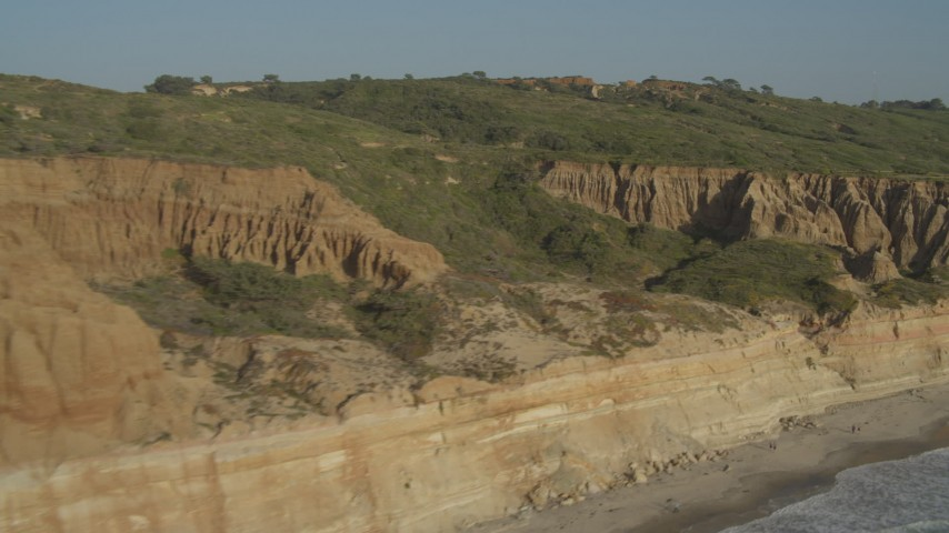 4K aerial video fly over coastal cliffs to reveal a golf course, La Jolla, California Aerial Stock Footage | DCA08_259