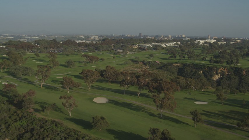 4K aerial video of flying over and panning across a gold course, La Jolla ,California Aerial Stock Footage | DCA08_260