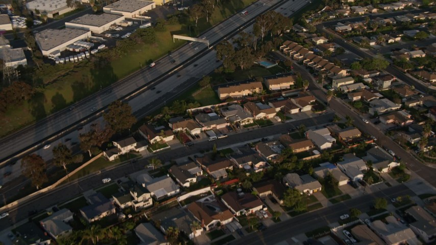 4K aerial video fly away from freeway and tract homes, Clairemont Mesa East, California, Sunset Aerial Stock Footage | DCA08_270