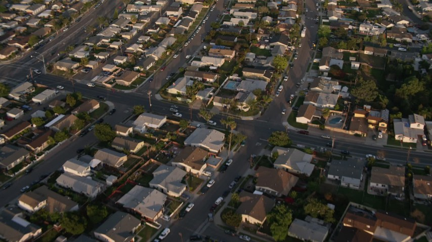 4K stock footage aerial video of a reverse view of suburban tract homes, Bay Ho, California, Sunset Aerial Stock Footage | DCA08_274
