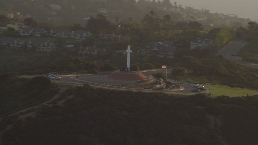 4K stock footage aerial video orbit the Soledad Cross religious monument in La Jolla, California, Sunset Aerial Stock Footage | DCA08_278